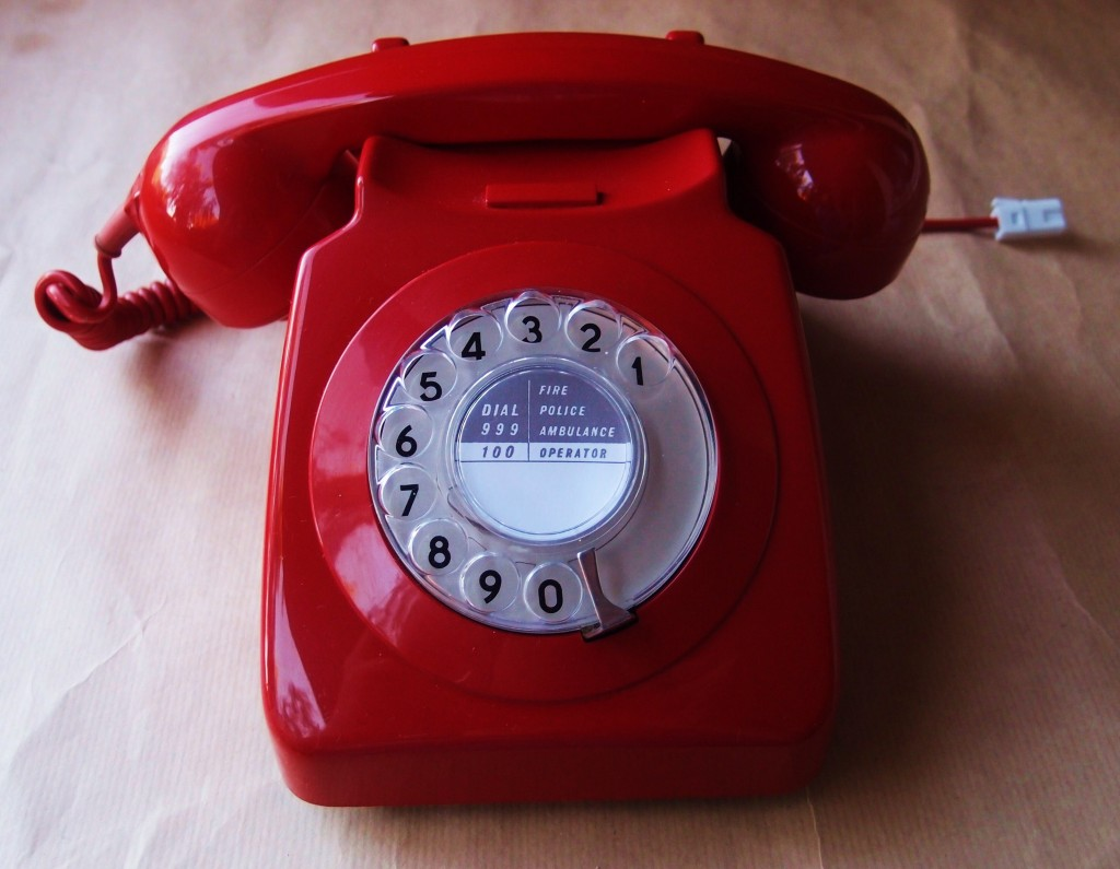 old fashioned red rotary dial phone